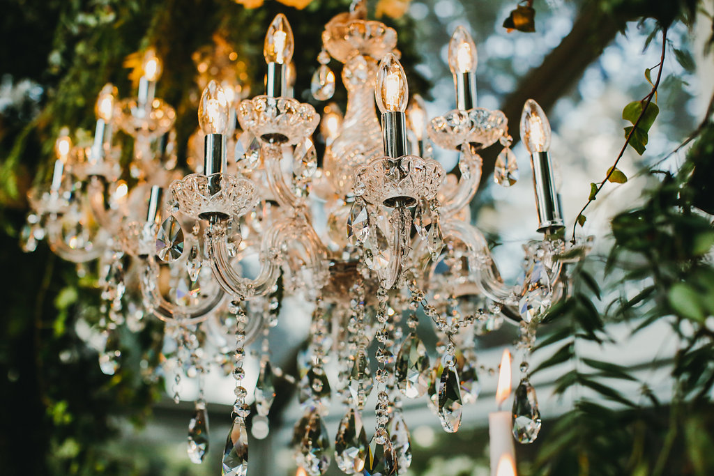 hanging chandeliers - photo by Lara Hotz http://ruffledblog.com/secret-garden-inspired-australian-wedding