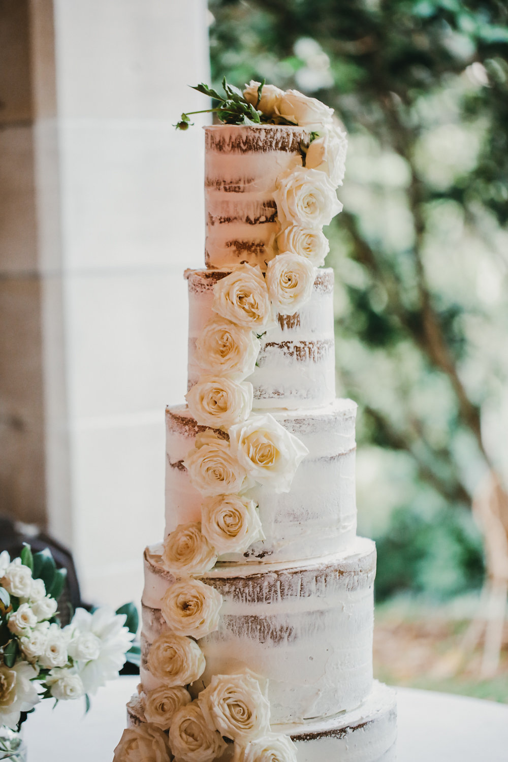 tiered wedding cake with flowers - photo by Lara Hotz http://ruffledblog.com/secret-garden-inspired-australian-wedding