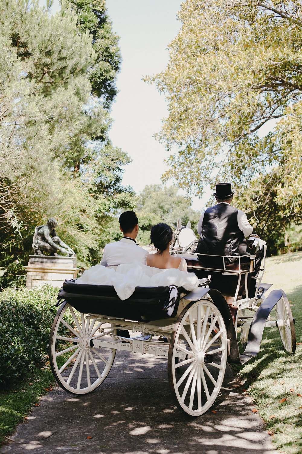 carriage recessional - photo by Lara Hotz http://ruffledblog.com/secret-garden-inspired-australian-wedding