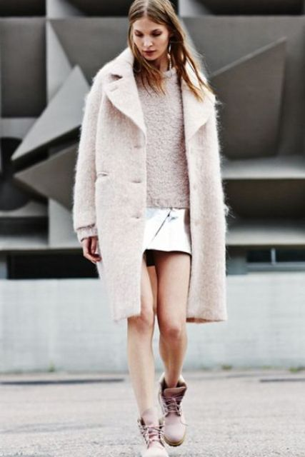With warm knee-length coat and mini skirt