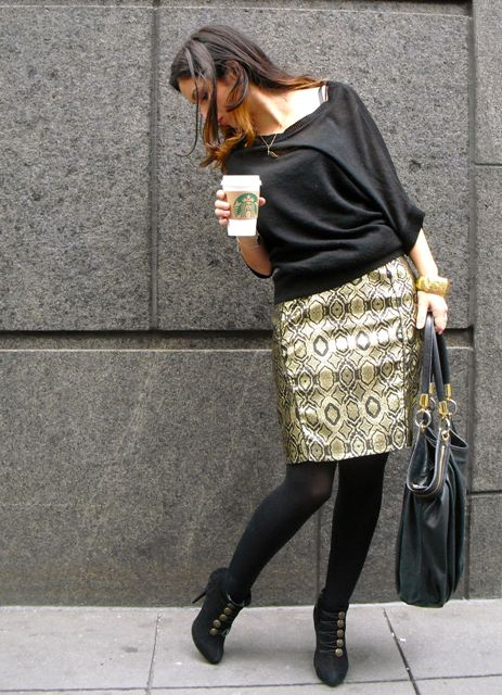 With black loose blouse, black ankle boots and gray big bag