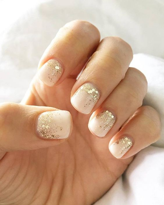 white nails with large gold sequins