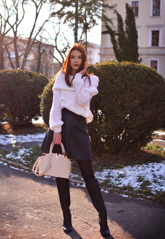 white off the shoulder sweater, black skirt, tall boots