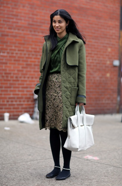 With green blouse, flats, white bag and green coat