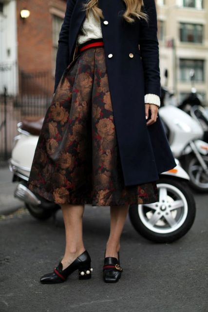 With midi coat, shirt, red belt and black shoes