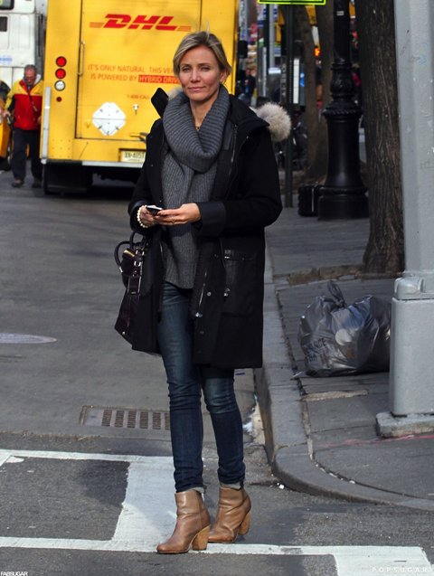 With skinny jeans, ankle boots and black knee-length coat