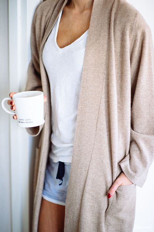 shorts, a white tee and a long neutral cardigan
