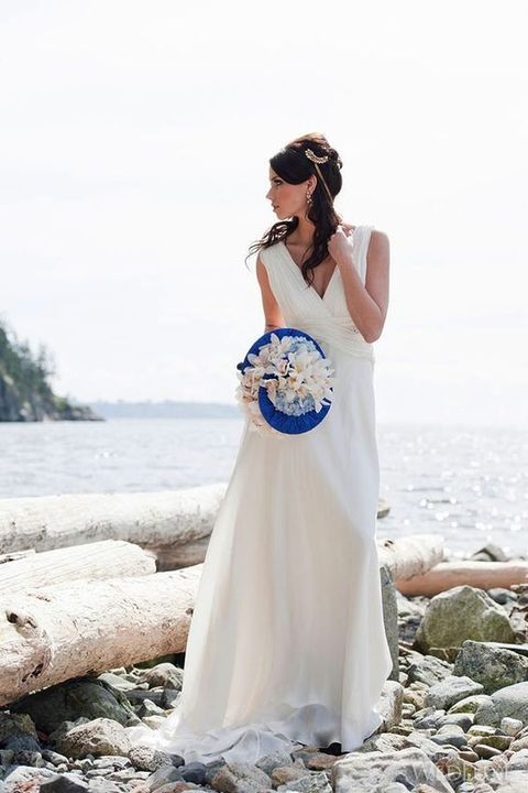simple white V neck wedding dress is ideal for a Greek wedding