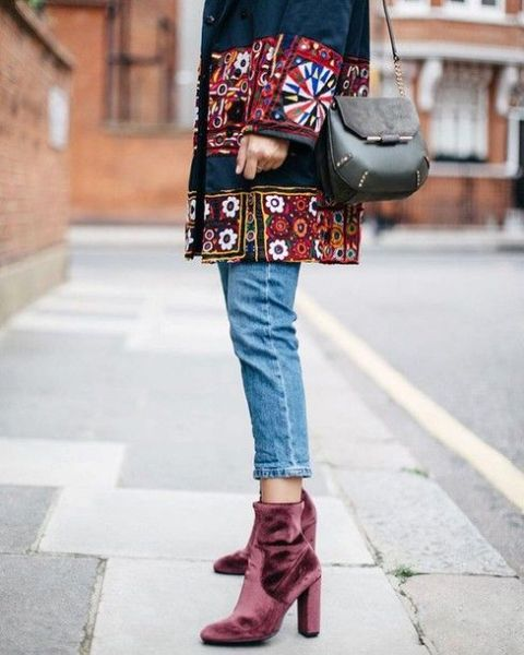 With embellished coat, jeans and mini bag