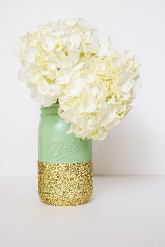 mint and giltter mason jar with white hydrangeas for a wedding centerpiece
