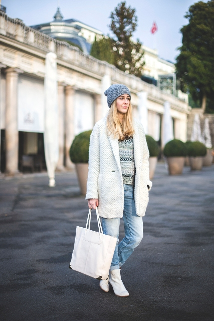 With printed sweater, cuffed jeans, beanie and white coat