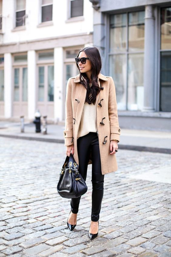 leggings, a neutral sweater, a camel coat and heels