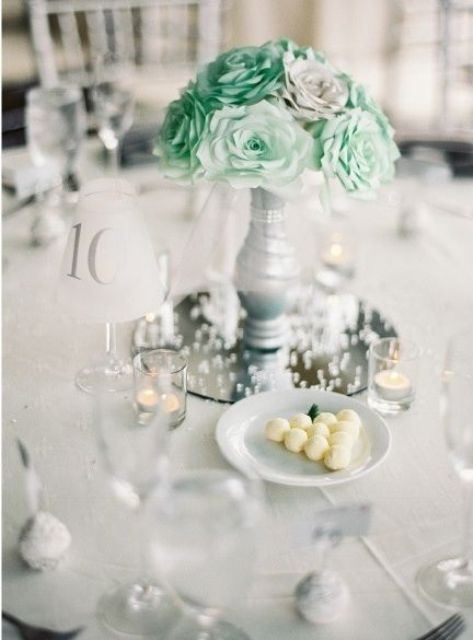 grey vase with mint paper flowers for a centerpiece