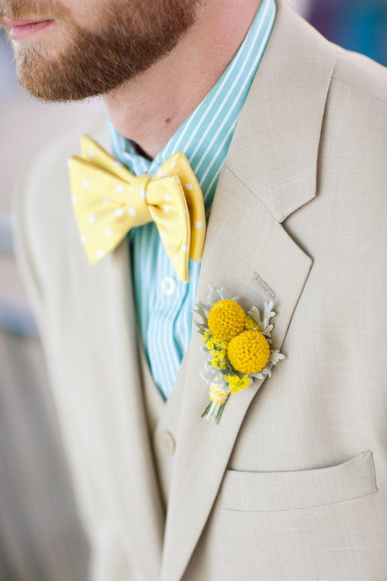 a yellow polka dot bow tie and a billy ball boutonniere, a striped mint shirt