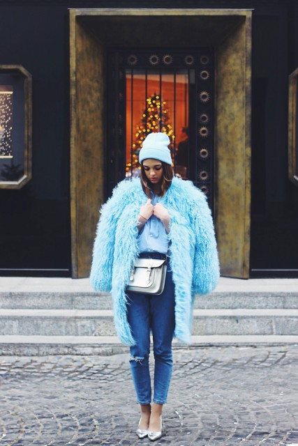 With faux fur knee-length coat, crop jeans and heels