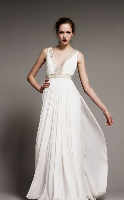 airy flowing Grecian wedding gown with a V neckline and gold lace