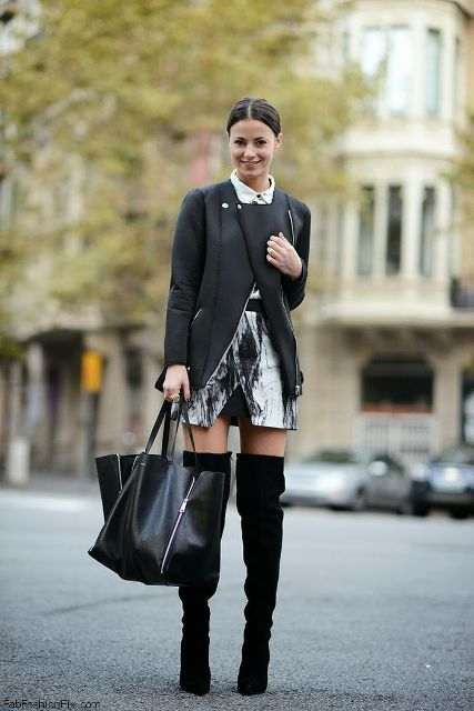 With printed skirt, black jacket and big bag