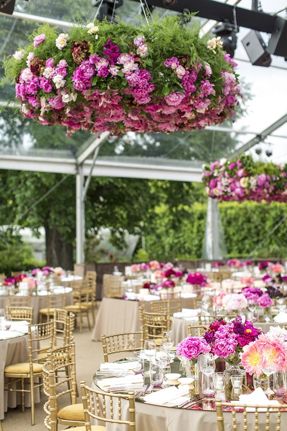 bold pink flower chandelier over the reception to fit the color scheme