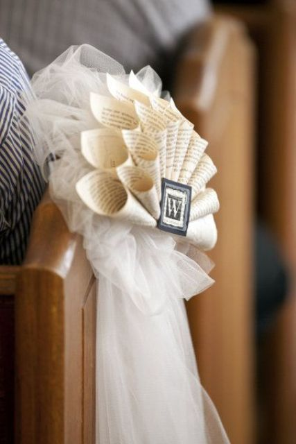 book page fans with monograms to decorate your wedidng aisle