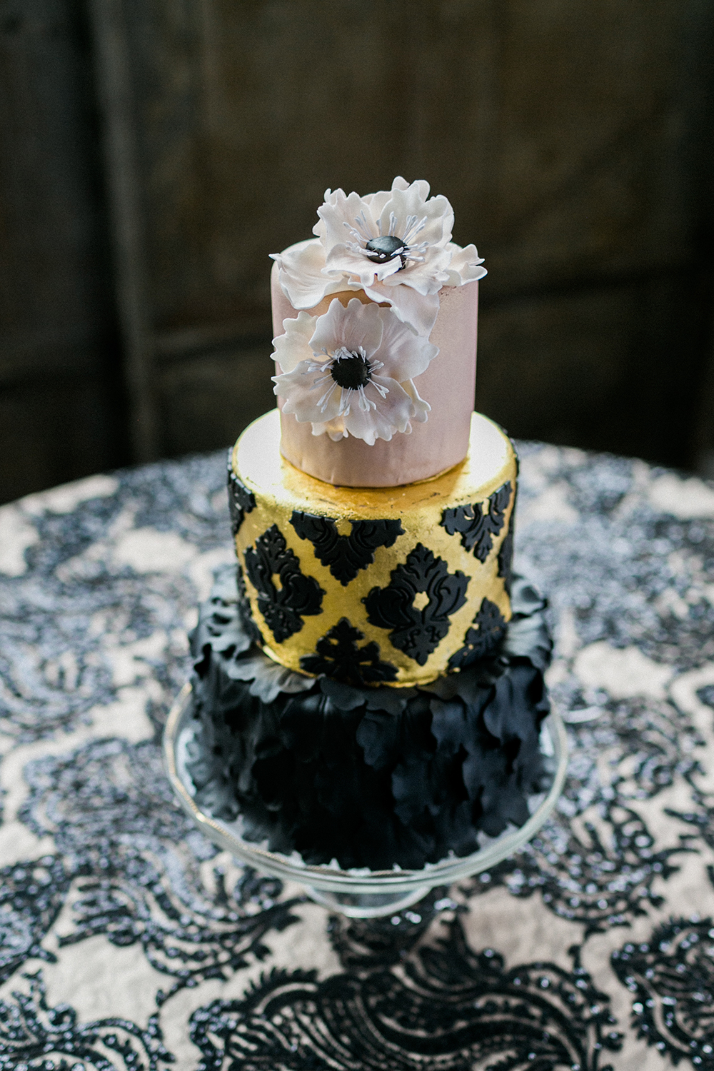 black gold and pink wedding cake - photo by Alexis June Weddings http://ruffledblog.com/industrial-glam-wedding-inspiration