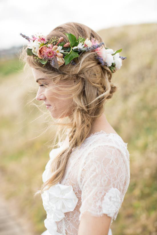messy braid and a large fresh flower crown