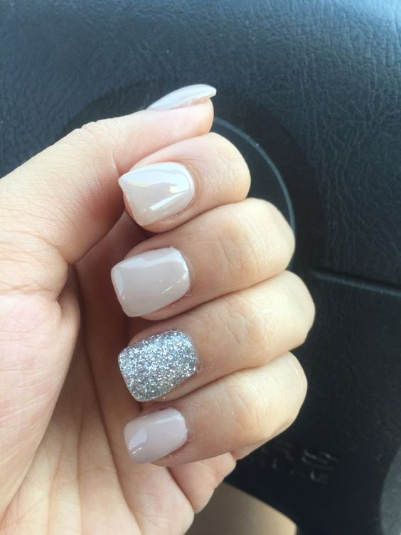 nude nails with a silver accent nail