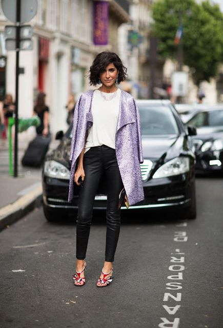 With white loose shirt, leather pants and heels