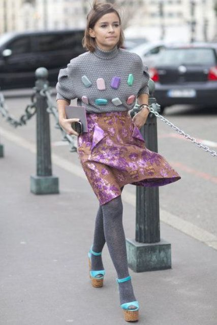 With funny and unique sweater, gray tights and platform shoes