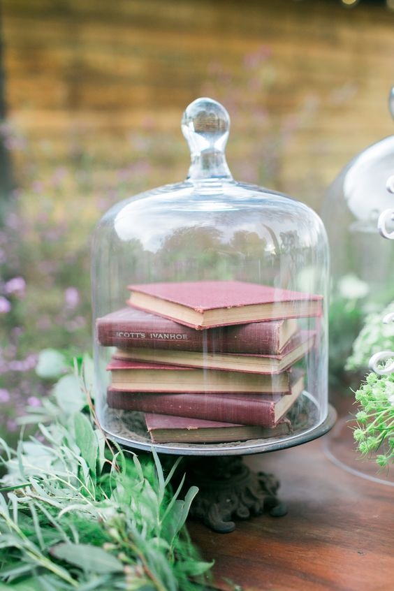 old books with words on pages in a cloche