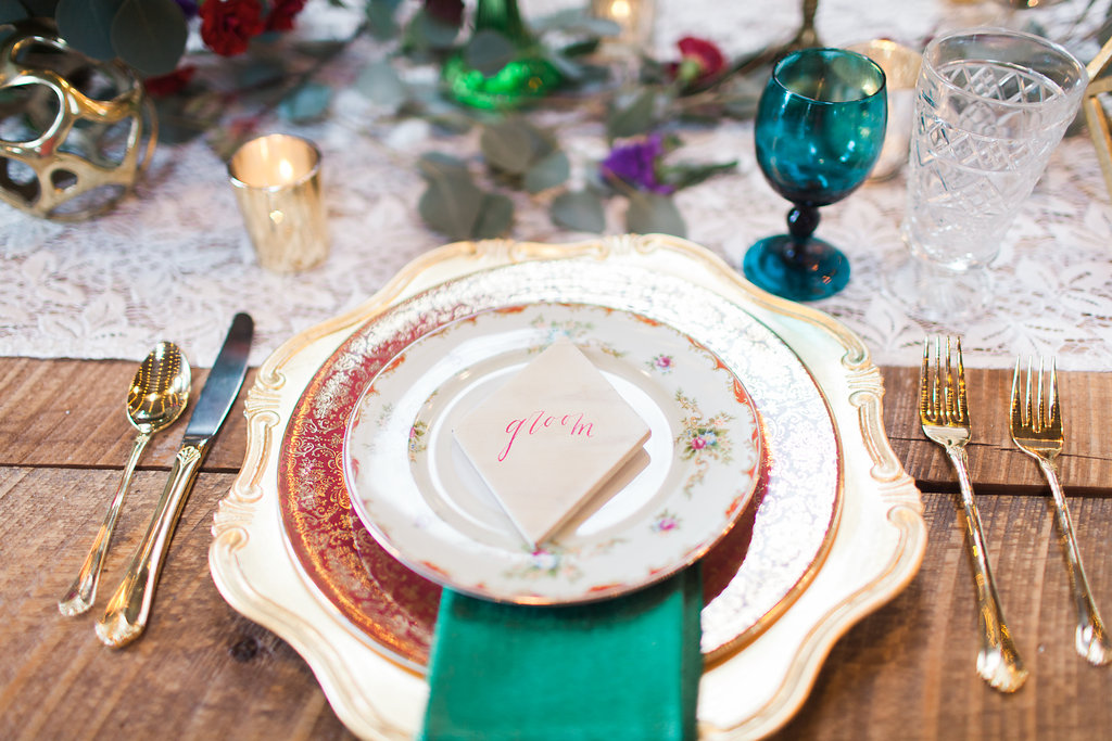 place setting - photo by Elizabeth Marie Photos http://ruffledblog.com/gold-and-plum-wedding-inspiration-with-hayley-paige-gown