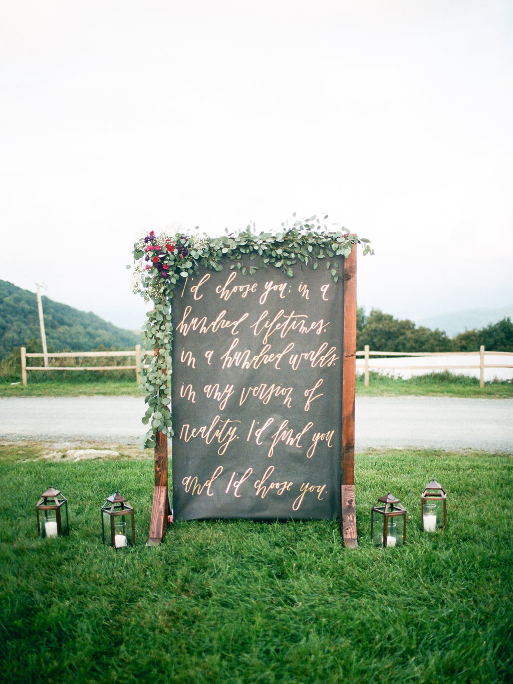 handwritten ceremony backdrop - photo by Elizabeth Marie Photos http://ruffledblog.com/gold-and-plum-wedding-inspiration-with-hayley-paige-gown