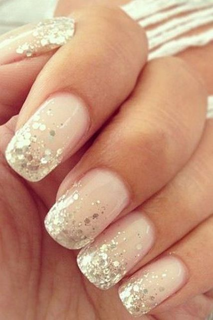 blush nails with gold sequins on the edge