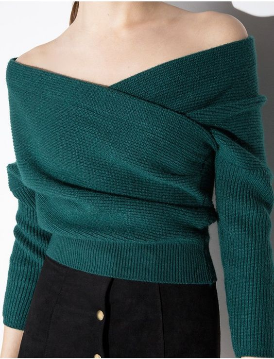 emerald off the shoulder sweater and a black button down skirt