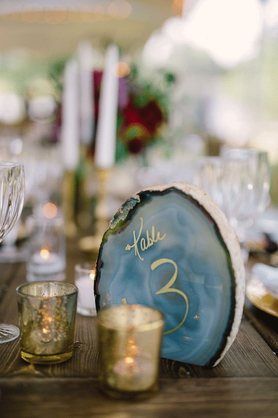geodes are hot in wedding decor, and you can write table numbers with gold on them