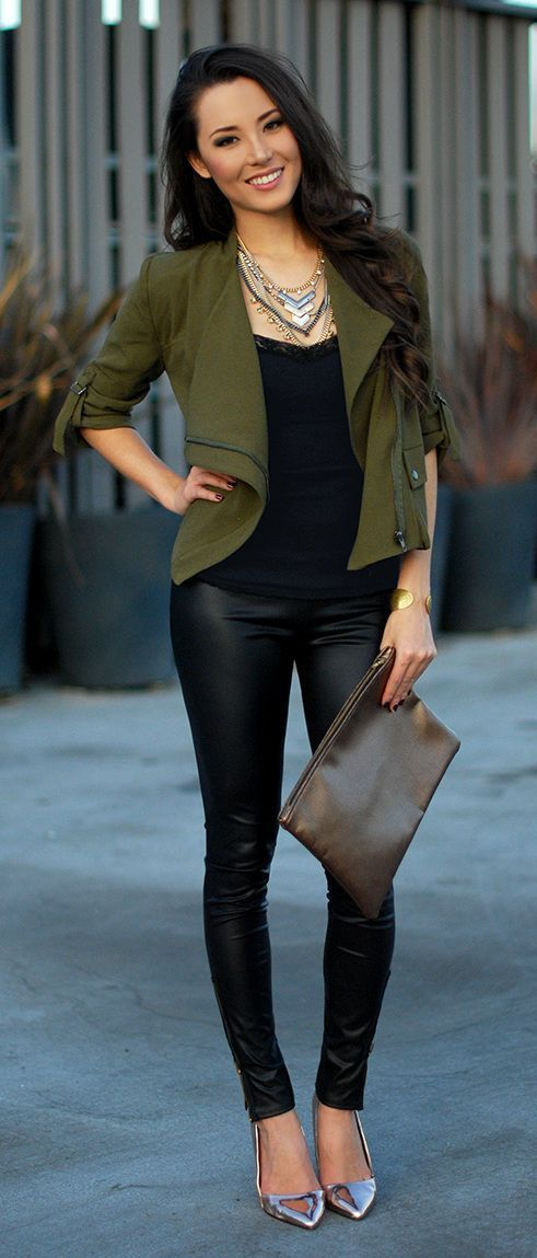 black top, and olive green jacket, metallic shoes