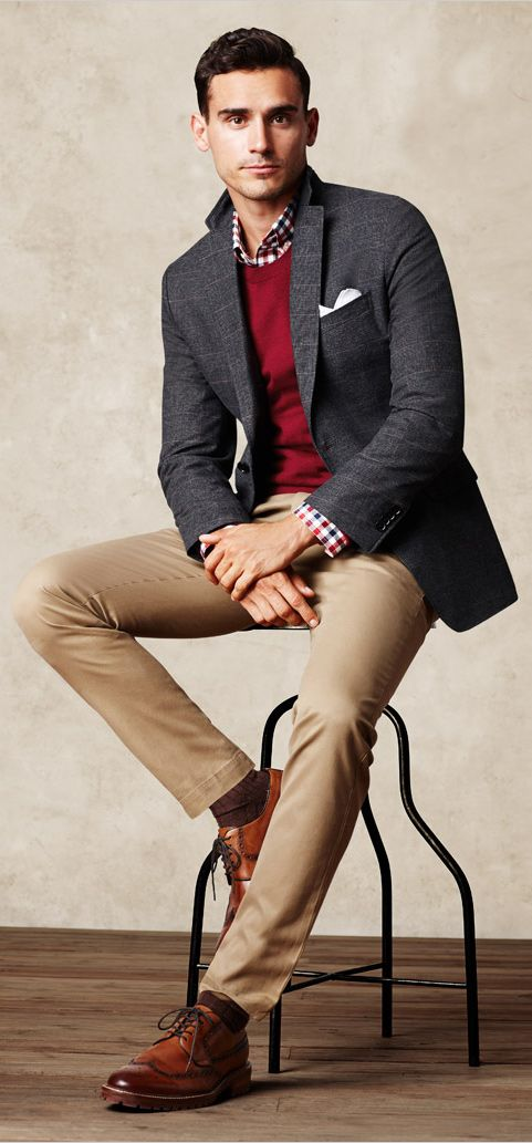 ocher pants, a red sweater, a checked shirt and cognac shoes
