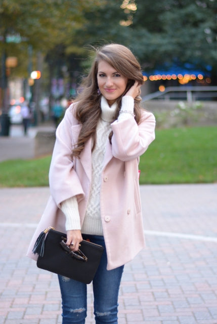 With cozy white sweater, jeans and black clutch