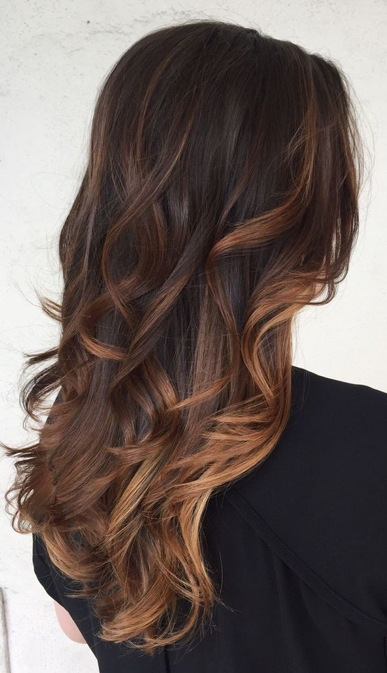 very dark brown hair with brown and dark caramel balayage