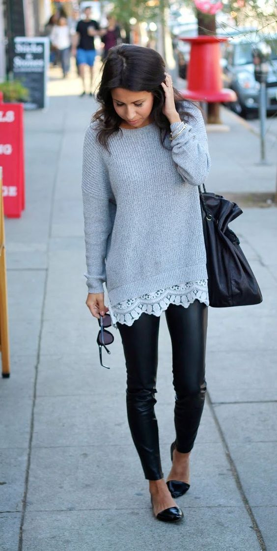 leather leggings, a long grey sweater with a lace hem and black flats