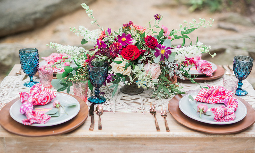 colorful boho table - http://ruffledblog.com/nomadic-cliffside-elopement-inspiration