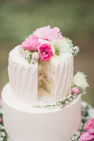 Pink wedding cake with flower cake topper   Joy Michelle Photography