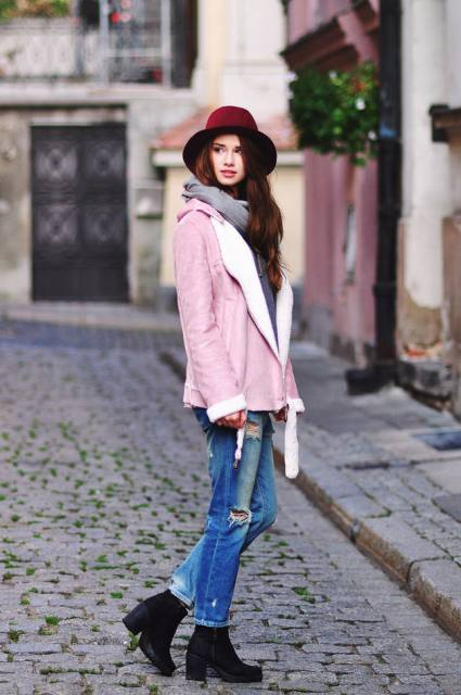 With gray scarf, jeans, ankle boots and marsala hat