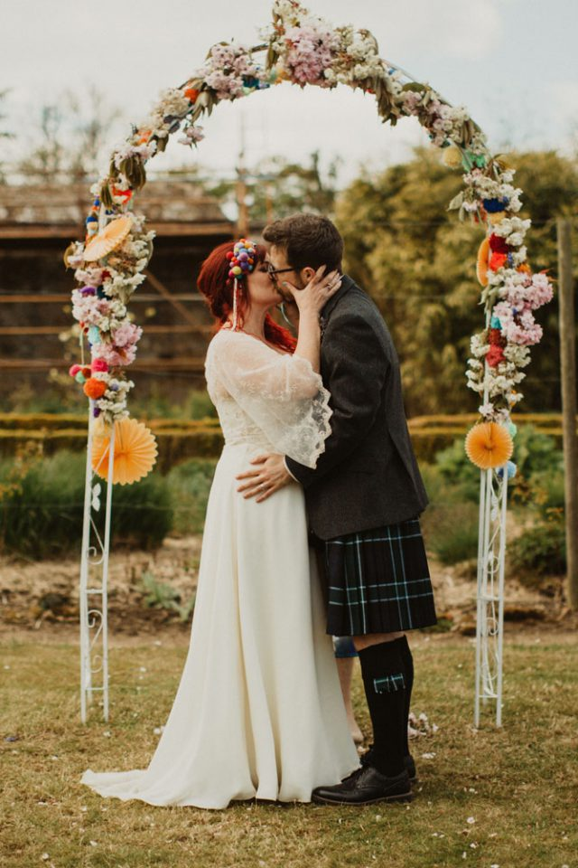 This colorful wedding was full of pompoms, bold colors and music and paper fans