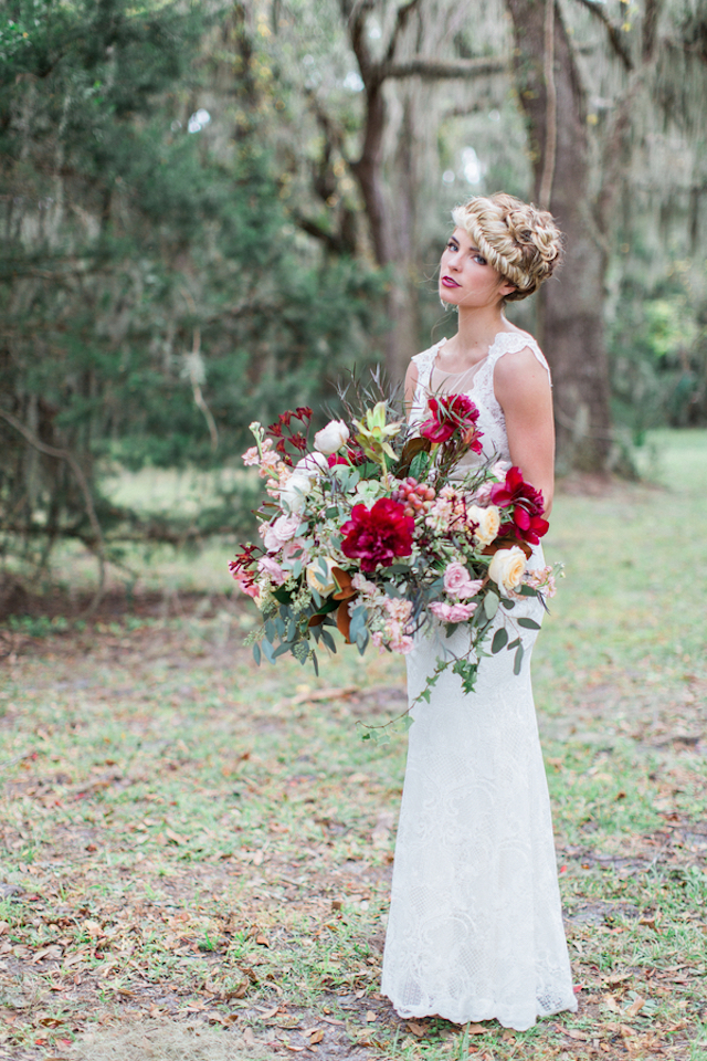 Oversized bridal bouquet with crimson peonies | Flora + Fauna Photography