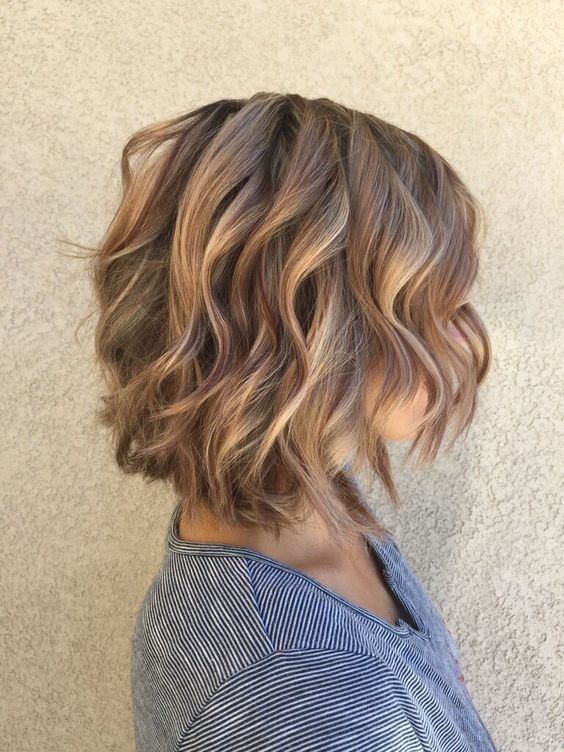 mahogany lowlights and soft caramel highlights with a layered bob