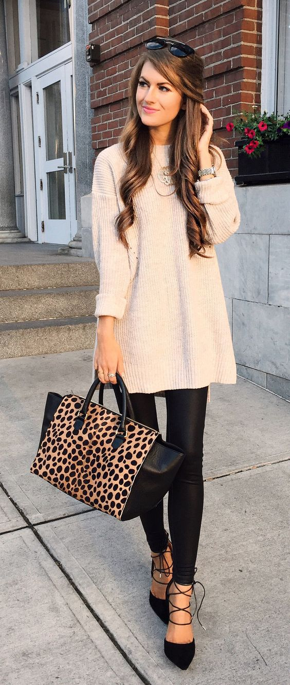 faux leather, a neutral oversized sweater and lace up heels