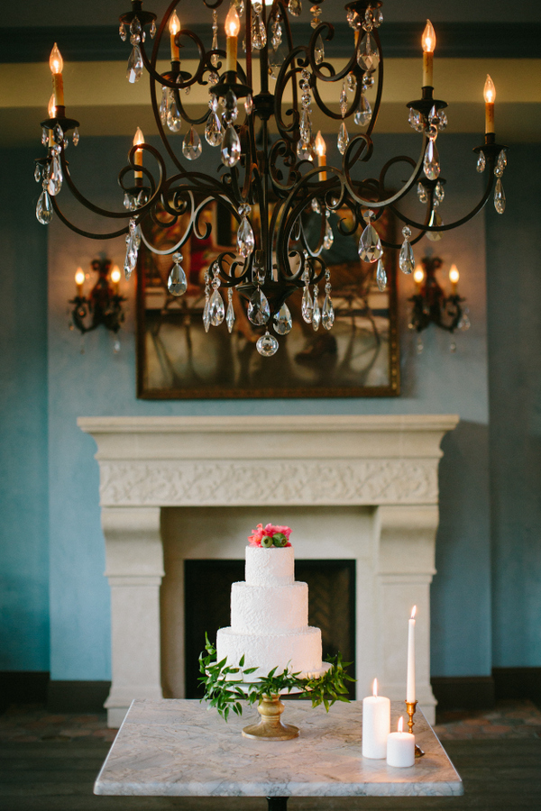 A crystal chandelier, a fireplace and a fountain can add Spanish flavor to your wedding