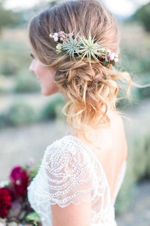 side updo with fresh succulents and flowers for a desert wedidng