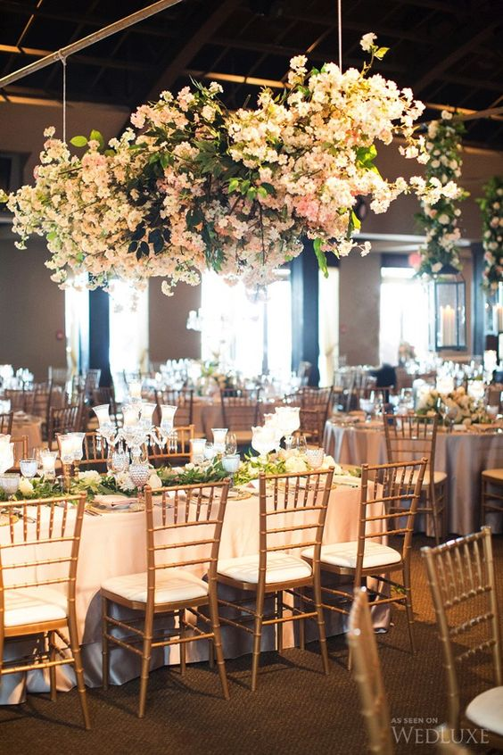 lush blush floral chandeliers over the reception