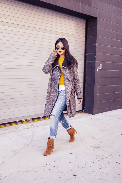 With distressed jeans, yellow and white shirt and midi coat